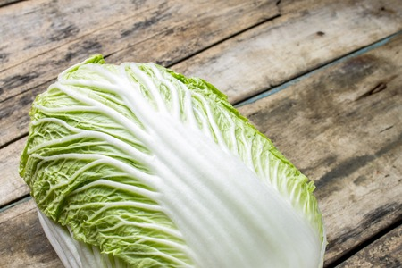 Fresh green cabbage on wooden table. Healthy food background photo