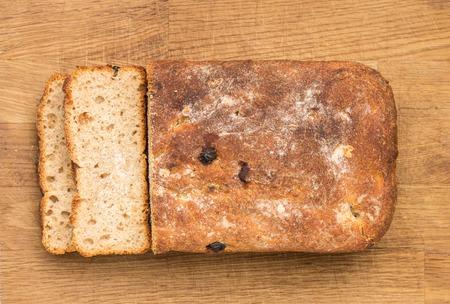unleavened: Sliced loaf of homemade unleavened sweet wheat bread with raisin. Top view image