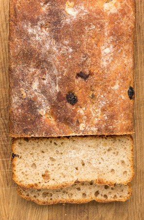 unleavened: Sliced loaf of homemade unleavened wheat bread with raisins. Top view image