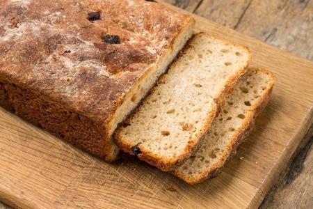 unleavened: Sliced loaf of homemade unleavened wheat sweet bread on wooden table Stock Photo