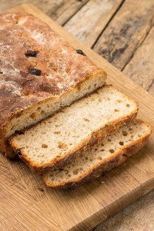 unleavened: Sliced loaf of homemade unleavened wheat bread. Rural bakery background