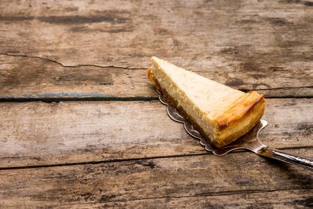 Cheesecake slice on wooden background. Recipe and menu dessert background