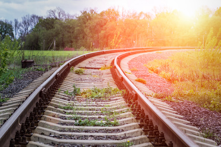 Old Railway in countryside. Scene of railroad in beams of sunset.