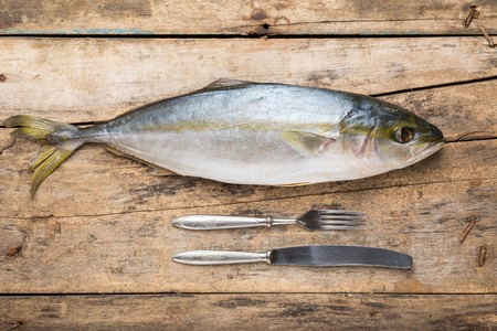 thunnus: Seafood culinary recipe background. Tuna fish on wood table top view image