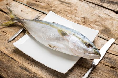 thunnus: Raw eating background. Fresh tuna on white plate served with silverware