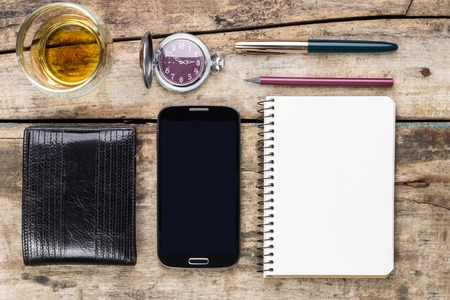 whisky glass: Mens mock up business set on wooden background. Wallet, smartphone, notebook  and glass of whisky top view image