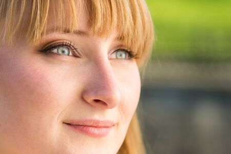 close up eyes: Young confident student girl with grey eyes. Close up portrait with copy space aside Stock Photo