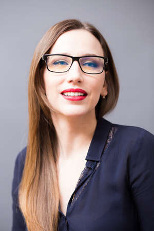 glasses model: Young attractive smiling businesswoman in eyeglasses. Happy successful woman with dark long hair