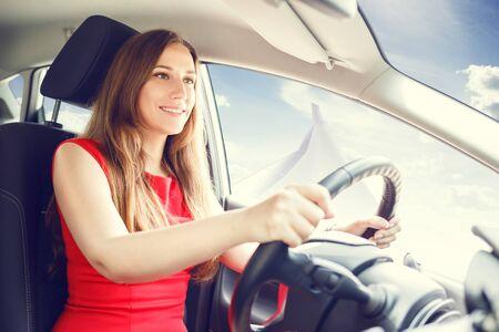 Young confident woman piloting small jet aircraft car. Future transporting concept Foto de archivo