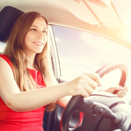rented: Young happy woman driving a new or rented car. Rent car background