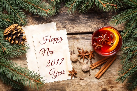New Year 2017 card with Christmas decorations and mug of mulled wine