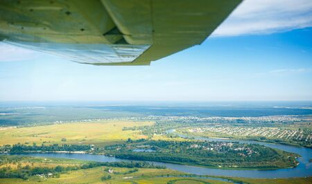 Aerial view from plane on beautiful country scene with curved river