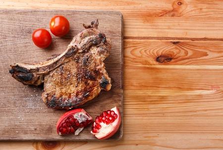 rib eye: Rib eye steak with tomatoes and pomegranate
