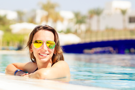 Young hispanic woman relaxing on summer vacations Stock Photo