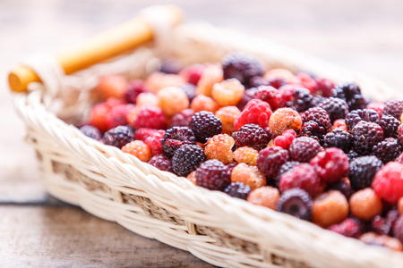 Close up image of wild berries in wicker basket