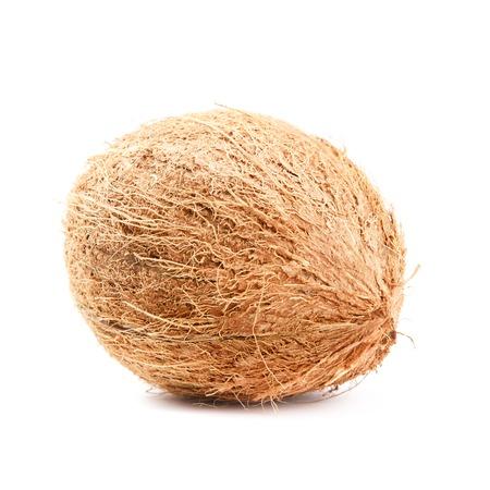 Whole hairy coconut isolated on white background