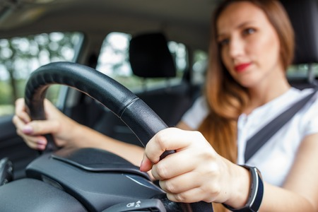 Young woman driving car on the road