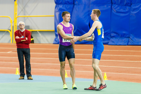 SUMY, UKRAINE - JANUARY 28, 2018: Vitaliy Butrym after win in 400m race on Ukrainian indoor track and field team championship 2018 Editorial