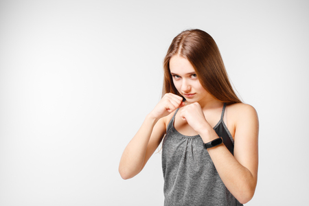 Young boxing girl isolated on white background Banque d'images