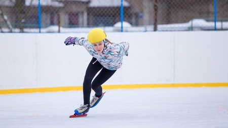 Speed skating young girl on training rink