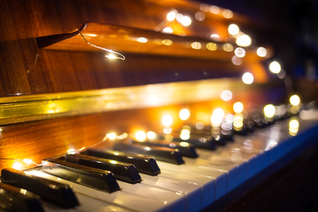 Piano keyboard with christmas light in the evening