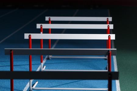 Row of hurdles for sprint training on the lane 版權商用圖片