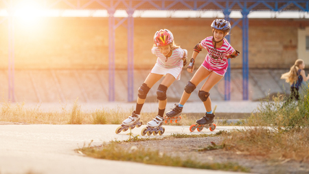 Two girls training in speed skating on rollerdrome