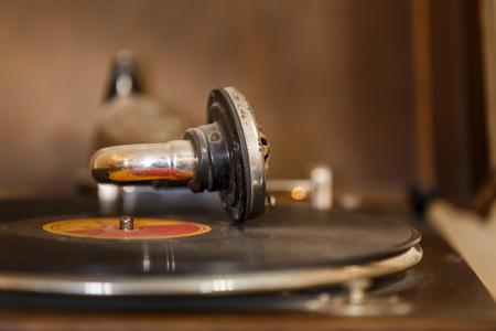 Retro gramophone with vinyl disc on it