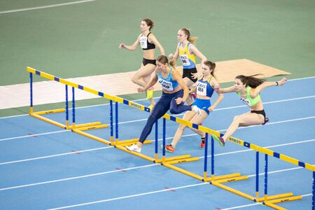 SUMY, UKRAINE - FEBRUARY 22, 2020: falsestart on 60m hurdles sprint at Ukrainian indoor track and field championship 2020.