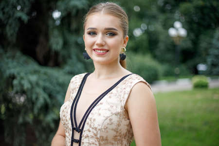 Portrait of beautiful teenage girl in evening dress and makeup Stock Photo