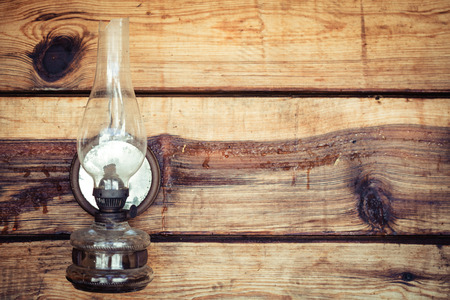 paraffin: paraffin lamp on wooden wall