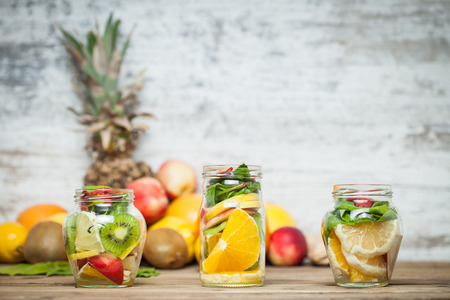 Fresh cutted fruit in jar Imagens
