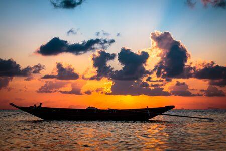 thani: Fisherman boat with sunset scene in koh phangan. Stock Photo
