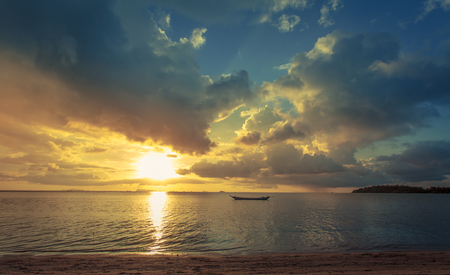Fisherman boat with sunset scene in koh phangan. Horizontal image.