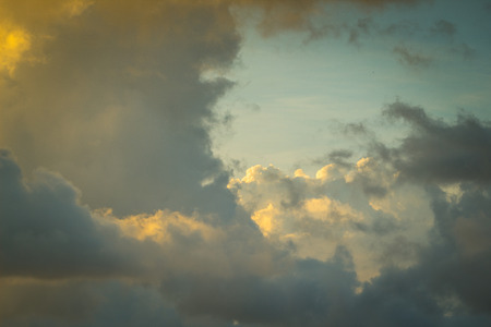 Beautiful cloudscape background with yellow and blue as main colors.