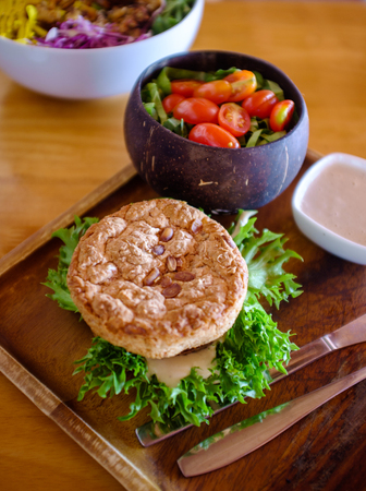 vegetable mushroom burger with salad and topping. Stock Photo