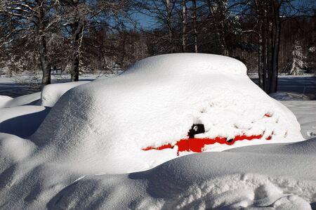 heavily: Car in a snowdrift