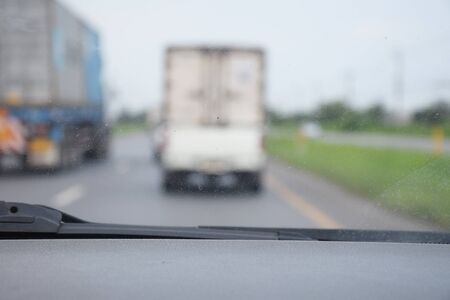 defocus: Defocus or blur background with traffic urban road. Inside view.
