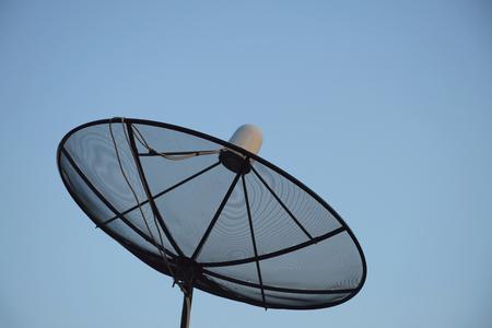 satelite: Satellite dish on clear sky background. Stock Photo