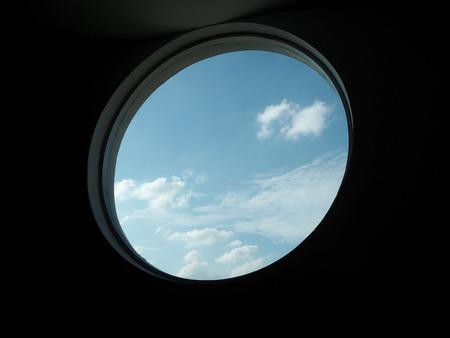 key to freedom: Sky from circle window. Stock Photo