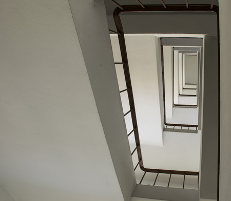 bannister: looking up stairwell building. Abstract architecture background.