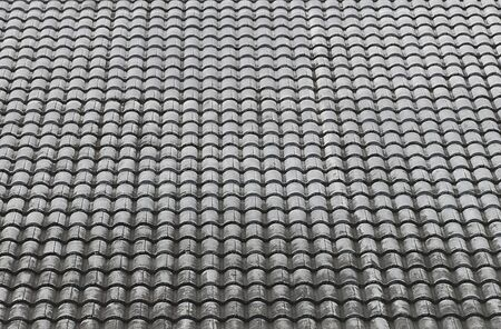 Close up roof tiles texture with blue sky background.