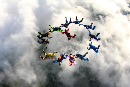 parachute jump: Skydivers above the clouds Stock Photo