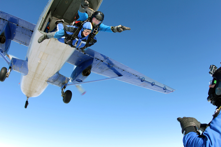 man flying: Skydiver cameraman is making film about jump. Stock Photo