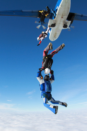 Two skydivers have jumped out of a plane.