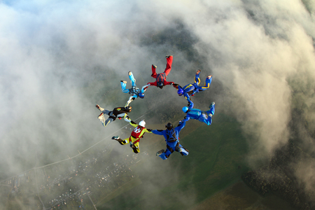 man flying: Seven skydivers in the sky Stock Photo