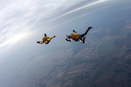Two skydivers in older equipments.