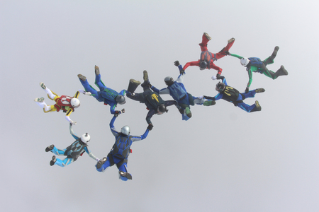 parachute jump: Skydive formation in the cloud. Stock Photo