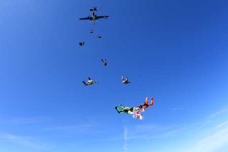 man flying: Skydive formation has just jumped out.