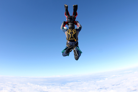 Two skydivers above the clouds Stock Photo